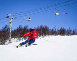 man skiing ski hill